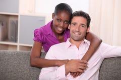 Couples dans leur salon Photographie stock