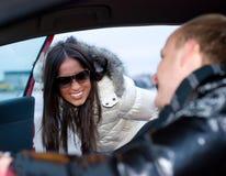 Couples dans un véhicule Photographie stock libre de droits