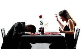 Couples dating dinner heart attack dead collapsing silhouettes Royalty Free Stock Photo