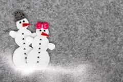 Couples de bonhomme de neige, l'espace de copie Image stock