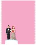 Couples de gâteau de mariage Photo stock