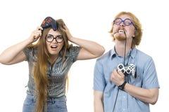 Couples de jeu jouant des jeux images stock