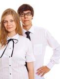 Couples de l'adolescence sérieux dans la robe de bureau Photos libres de droits
