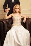Couples de luxe dans l'intérieur riche Photographie stock