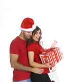 Couples de Noël heureux Photographie stock libre de droits