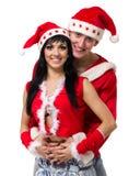 Couples de Noël heureux, d'isolement au-dessus du blanc Photos stock