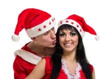 Couples de Noël heureux, d'isolement au-dessus du blanc Photographie stock libre de droits