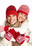 Couples de Noël heureux dans l'habillement d'hiver. Photos libres de droits