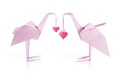 Couples de papier roses de flamant d'origami Photographie stock