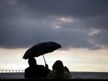 Couples de parapluie Image libre de droits