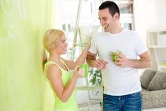 Couples de peinture sur la coupure Images stock
