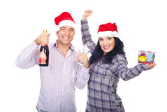 Couples de sourire heureux de Noël Photographie stock libre de droits