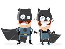 Couples de super héros dans des costumes noirs Photographie stock