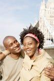 Couples de touristes en portrait de Londres. Photographie stock