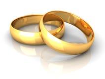Couples des boucles de mariage d'or sur le fond blanc Images libres de droits