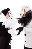 Clowns de couples montrant des mains de wirth de coeur Photographie stock