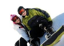 Couples des snowboarders heureux Photographie stock libre de droits