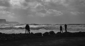 Couples, Doolin, Ireland B&W. Couples enjoy the evening light in Doolin on the Wild Atlantic Way Royalty Free Stock Photos