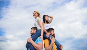 Couples on double date. Inviting another couple to join. Twice fun on double date. Friendship of families. Couples in. Love having fun. Men carry girlfriends on royalty free stock photos