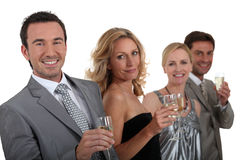 Couples drinking champagne Royalty Free Stock Photos