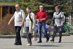 Couples of elderly people walk in city park Royalty Free Stock Photo
