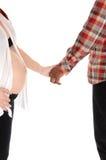 Couples enceintes tenant des mains Images libres de droits