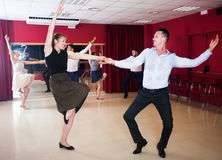 Couples enjoying active boogie-woogie Royalty Free Stock Photos