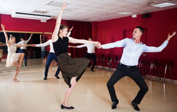 Couples enjoying active boogie-woogie Stock Images