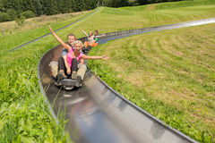 Couples Enjoying Alpine Coaster Luge Stock Photography