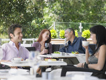 Couples Enjoying Drinks At Cafe Stock Images