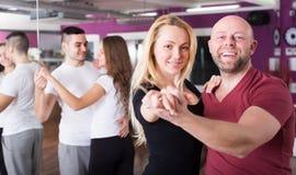 Couples enjoying of partner dance Royalty Free Stock Photo