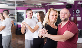 Couples enjoying of partner dance Royalty Free Stock Photo