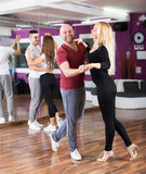 Couples enjoying of partner dance Stock Photo