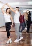 Couples enjoying of partner dance Stock Images