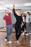 Couples enjoying of partner dance Royalty Free Stock Image