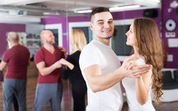 Couples enjoying of partner dance Royalty Free Stock Images