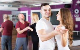 Couples enjoying of partner dance Royalty Free Stock Images