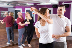 Couples enjoying of partner dance Stock Image