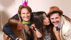 Couples enjoying in party photo booth stock footage