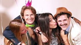 Couples enjoying in party photo booth stock video footage