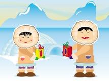 Couples esquimaux partageant des présents pour Noël Photos libres de droits