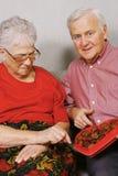 Couples et chocolat aînés Photographie stock libre de droits