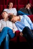 Couples et d'autres gens dans le cinéma Photo stock