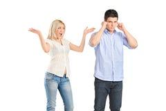 Couples fâchés de combat Photos libres de droits
