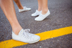 Couples feet on the road Royalty Free Stock Photos
