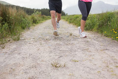 Couples feet running on a trail Stock Image