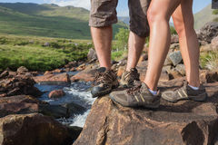 Couples feet standing at edge of river Royalty Free Stock Images