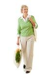 Couples : Femme avec les sacs d'épicerie réutilisables Image libre de droits