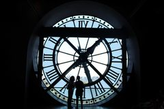 Couples in front of a clock royalty free stock photo