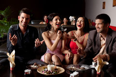 Couples funny dessert feeding Royalty Free Stock Photos